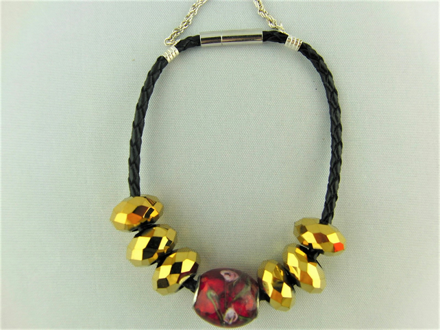 Red and Gold European Lampwork Bead Bracelet on a Black Plaited Leather Band