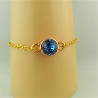 Blue Swarovski Crystal Bracelet with a Gold Plated Setting and Chain