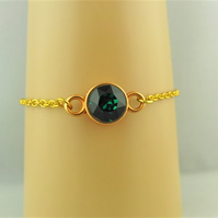 Green Swarovski Crystal Bracelet with a Gold Plated Setting and Chain