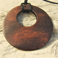Dark Brown Wooden Round Donut Pendant on a Black Waxed Cotton Cord