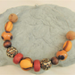 Orange Yellow and Brown Wood Acrylic and Cork Beaded Choker Necklace