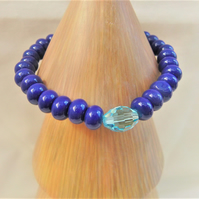 Stretch Bracelet Made With Cobalt Blue Rondelle Beads & A Pale Blue Crystal
