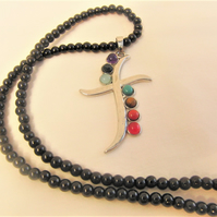 Stylised Cross Pendant with Chakra Stones on a Black Beaded Necklace
