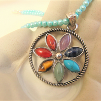 Chakra Semi Precious Floral Pendant on a Pale Blue Pearl Beaded Choker Necklace