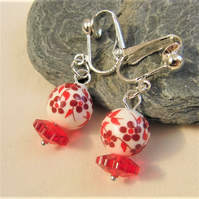 Red and White Bead Clip On Earrings With a Flat Red Flower Bead