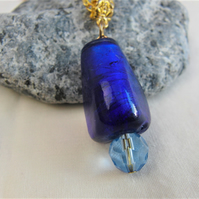 Large Blue Glass Bead with Blue Crystal Pendant Necklace on a Gold Plated Chain