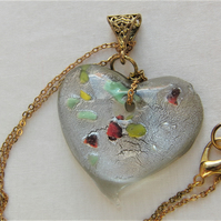 Clear Glass Heart Shaped Pendant with Green Yellow & Red Flecks on a Gold Chain