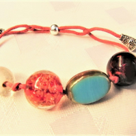 Blue Clear Red Glass Bead and Blue Ceramic Bead Bracelet on Pink Cord Base