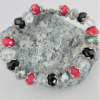 Red Black and Clear Crystal Bracelet with Silver Plated Bead Caps
