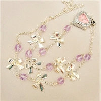 Heart Shaped Fob Watch on a Long Line Chain with Silver Bows and Lilac Crystals