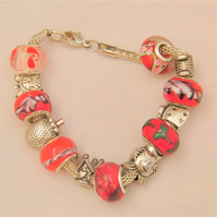 Red Lampwork Bead Bracelet with Silver Plated Charms on a Silver Snake Chain