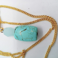 Turquoise and Blue Faceted Bead Pendant on a Gold Plated Chain