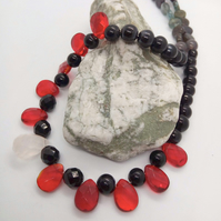 Black Beaded Necklace with Red and White Faceted Drop Beads