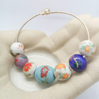 SALE - Bracelet With a Selection of Porcelain Beads on a Rigid Silver Base