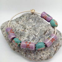 Bracelet with Purple & Blue Ceramic Beads On a Silver Plated Rigid Base