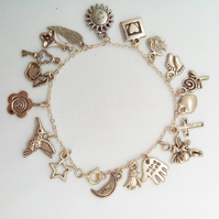Silver Plated Charm Bracelet with 18 Charms on a Silver Plated Chain