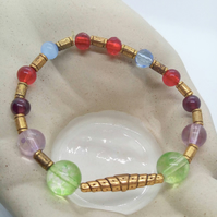 Multi Coloured Glass Bead Bracelet with Gold Plated Spacers and Spiral Bar