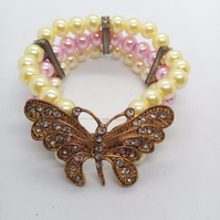 3 Strand Pearl Bracelet With A Gold Plated Rhinestone Butterfly Centrepiece