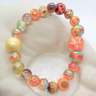 Shades of Orange Brown Gold and Red Beaded Stretch Bracelet