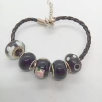 Black European Lampwork Bead Bracelet on a Black Plaited Leather Band