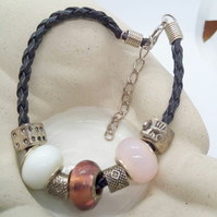 Leather Bracelet with Pink Purple and White Lampwork Beads & Silver Charms