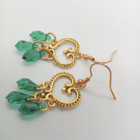 Earrings made with Green Crystal Beads and a Gold Chandelier Connector