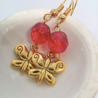Earrings With a Red Crystal Bead and a Gold Plated Butterfly Charm