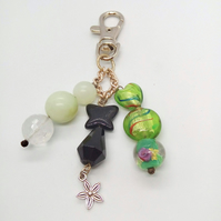 Beaded Bag Charm with Jade Beads Green and Black Glass Beads and a Flower Charm