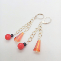 Lever Back Earrings Made With Orange Tapered Tube Beads And Red and Black Beads