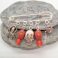 Kilt Pin with a Spider Skull and Pumpkin Charms and a Brown and Orange Charms