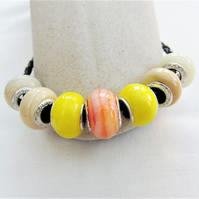 Yellow and Coffee Lampwork Bead Bracelet on a Plaited Leather Band