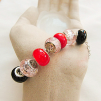Pink Red and Black European Lampwork Bead Bracelet on a Silver Plated Chain