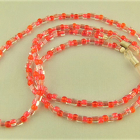 Cord for Glasses Made Using Small Red and Clear Glass Beads