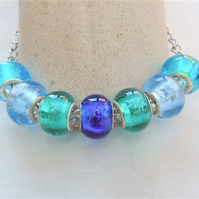Shades of Blue European Lampwork Bead Bracelet on a Silver Plated Chain
