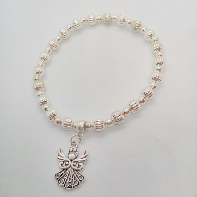 Stretch Christmas Bracelet with Silver Plated Beads and A Silver Angel Charm