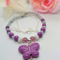 Purple and Grey Beaded Necklace with Purple Ceramic Butterfly Pendant