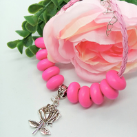 Pink Plaited Leather Bracelet with Pink Wooden Beads and a Silver Rose Charm