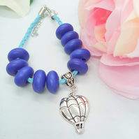 Blue Plaited Leather Bracelet with Blue Wooden Beads and a Silver Balloon Charm