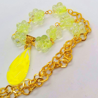 Yellow Glass Teardrop Pendant on a Flower Bead and Gold Chain Necklace