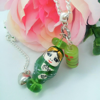 Green Russian Doll and Lampwork Bead  Pendant on a Silver Plated Chain