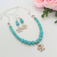 Blue Turquoise Bead and Silver Chain Necklace with Silver Plated Flower Charms