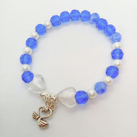 Stretch Bracelet with Blue and White Beads Heart Beads and a Silver Swan Charm