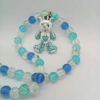 Blue and Silver Teddy Bear Pendant on a Blue Beaded Necklace