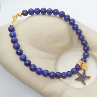Lapis Lazuli Beaded Bracelet With A Gold Plated Enamelled Starfish Charm