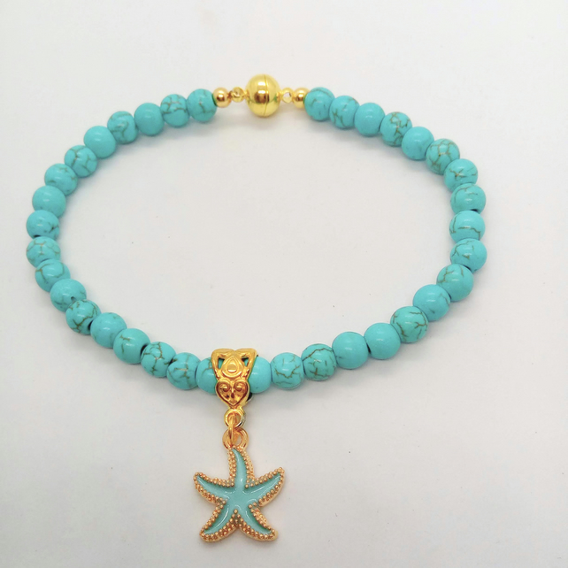 Turquoise Beaded Bracelet With A Gold Plated Pale Blue Enamelled Starfish Charm