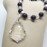 Small Clear Crystal Baroque Style Pendant on a Black and Clear Beaded Necklace