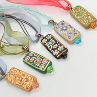 Rectangular Glass Bead with Painted Flower Pattern and a Crystal Pendant