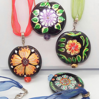 Pendant with Black Glass Circular Bead with Painted Flower Pattern and a Crystal