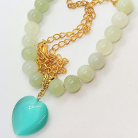 Teal Glass Heart Pendant on a Jade Bead and Gold Chain Necklace