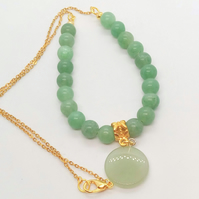 Green Jade Circular Pendant on a Soapstone Bead and Gold Chain Necklace